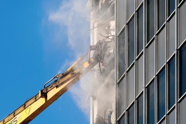 crane demolishing earthquake damage